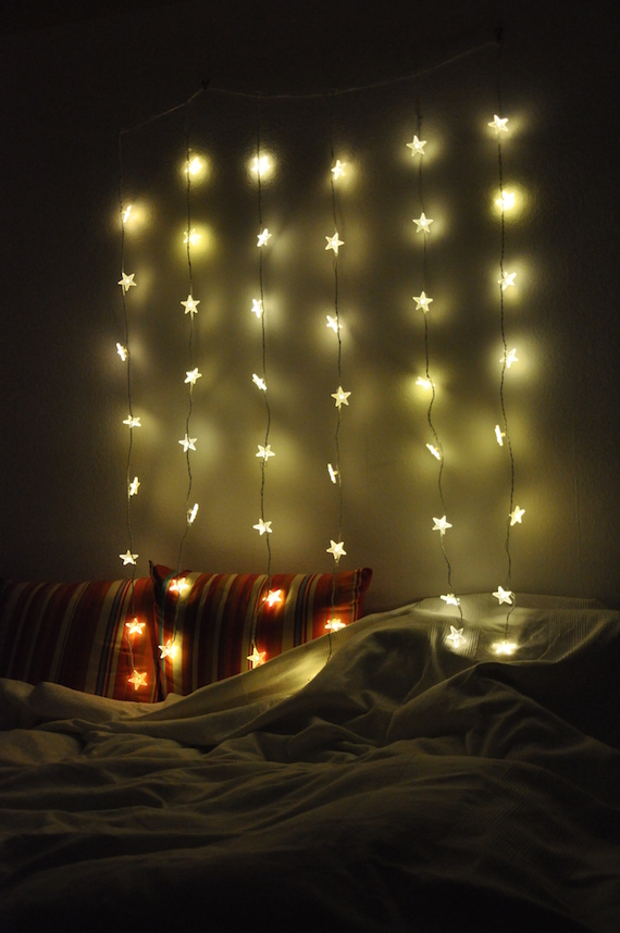 lighting which creates atmosphere over a cozy bed